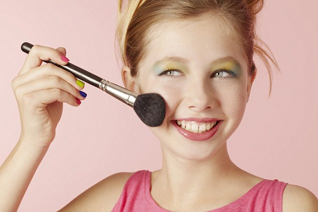 01 Nov 2012 --- Smiling girl wearing colorful makeup --- Image by © Emma Kim/cultura/Corbis